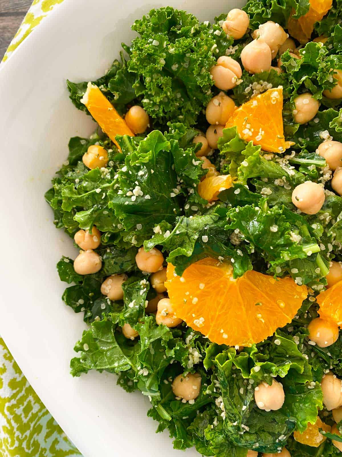 Close up of salad bowl with kale, chickpeas and hemp hearts.