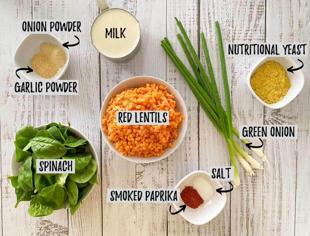 Ingredients to make lentil pancakes on grey deck.