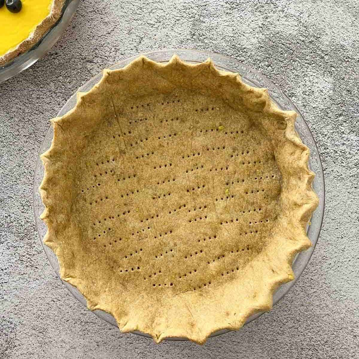 cooked pie crust in pie plate.