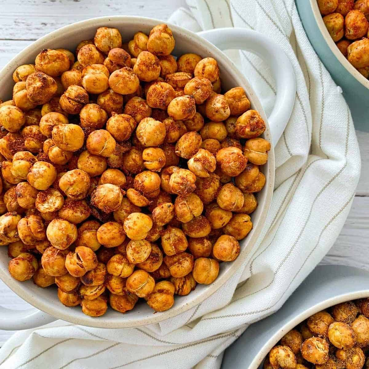 white bowl filled with air fried chickpeas.