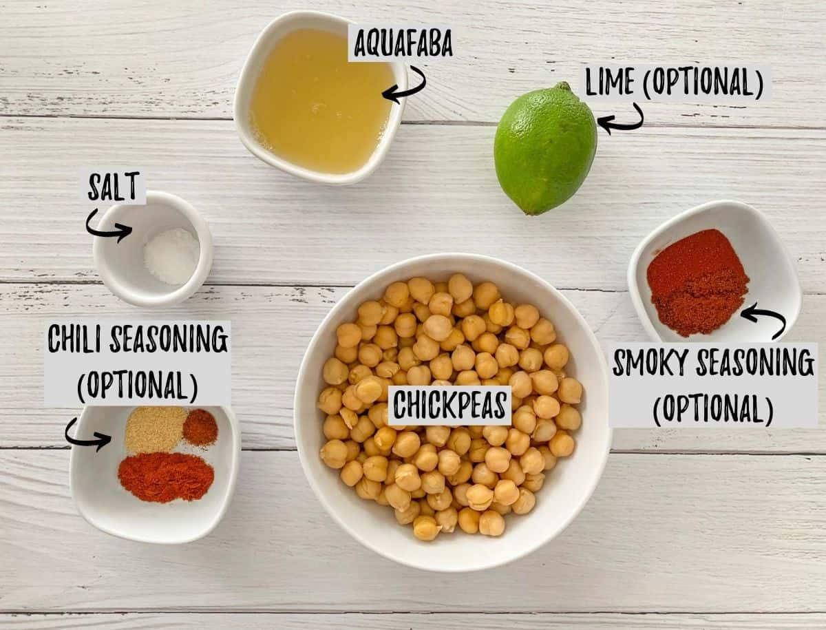 Ingredients needed to make air fried chickpeas scattered on white deck.