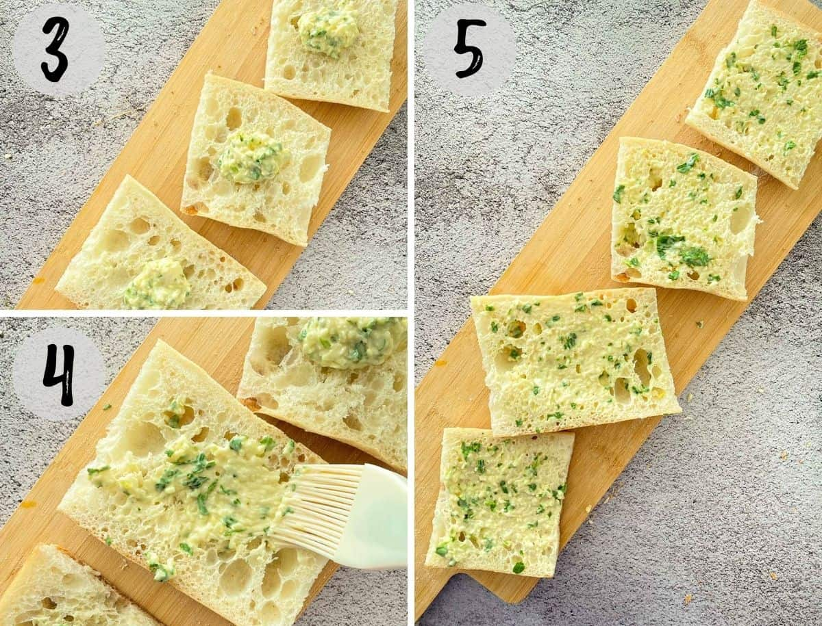 Slices of bread with garlic butter being spread on top.