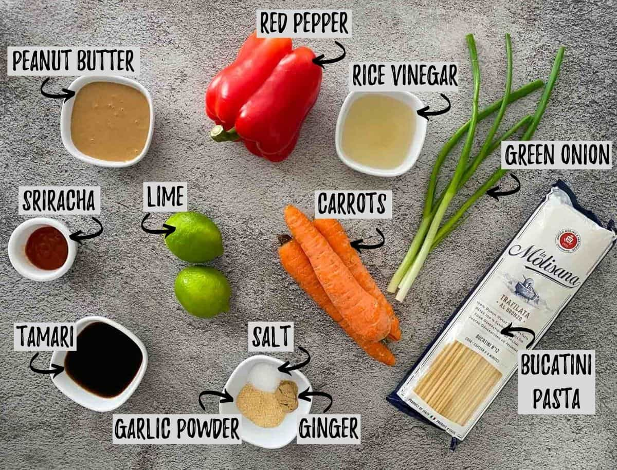 Ingredients needed to make instant pot noodles on concrete surface.