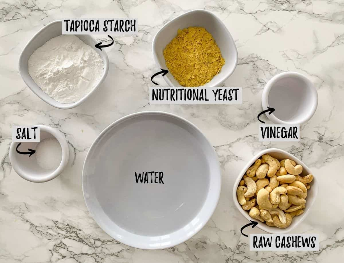 Ingredients to make vegan mozzarella cheese on marble counter.