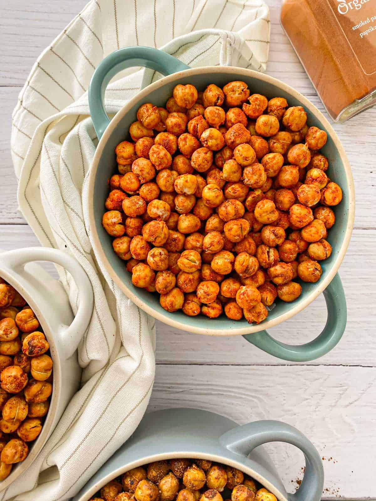 Smoky chickpeas in blue bowl with handles.