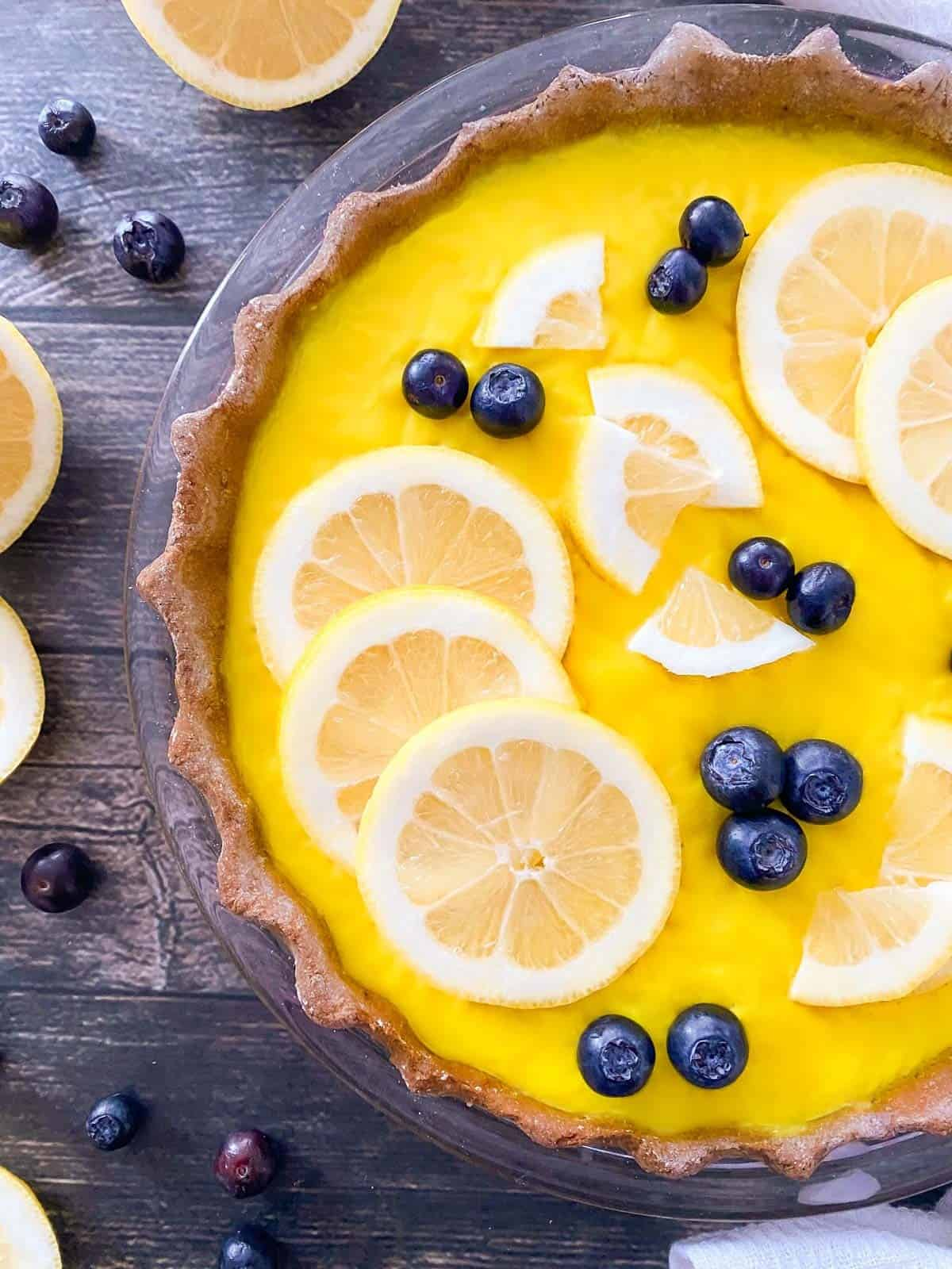 Close up of vegan lemon pie with lemon slices on top.