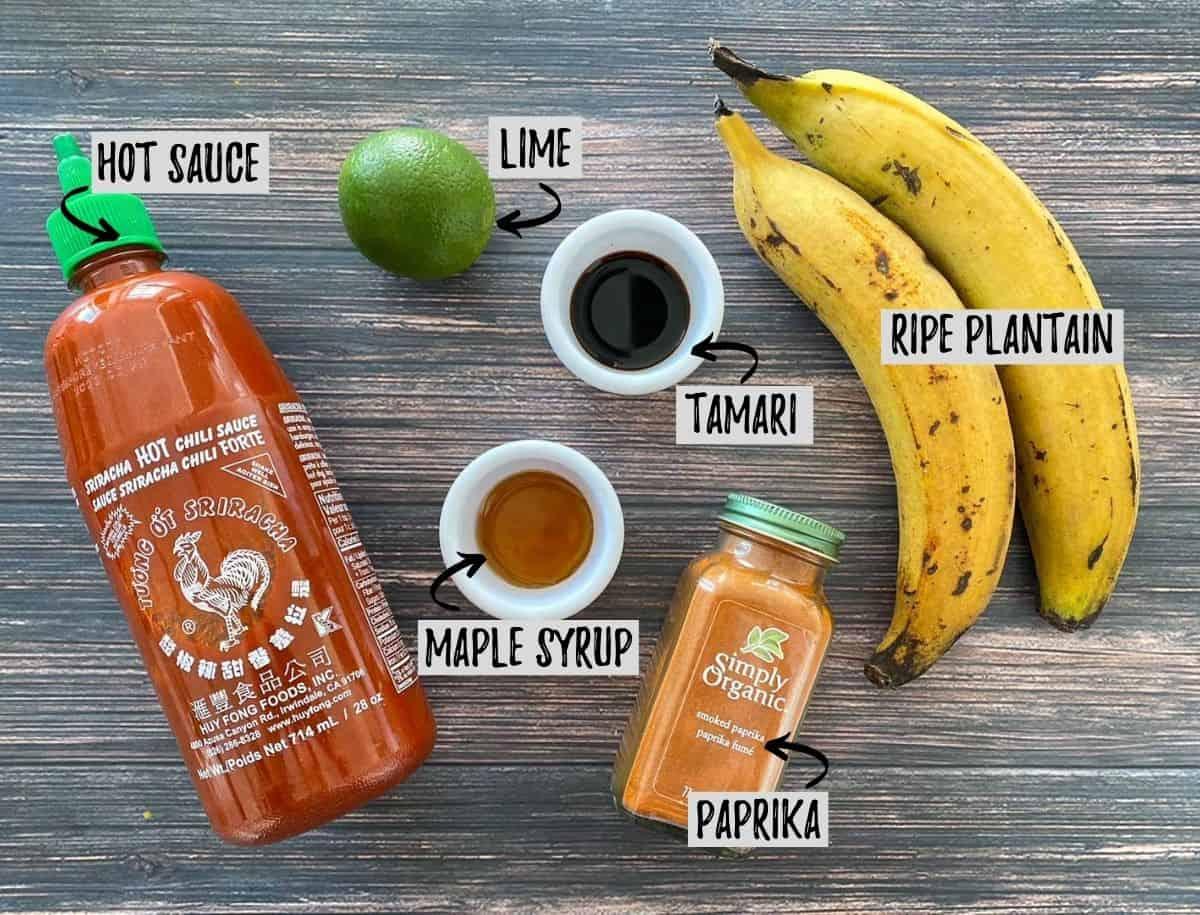 Ingredients to make air fryer plantains on brown deck.
