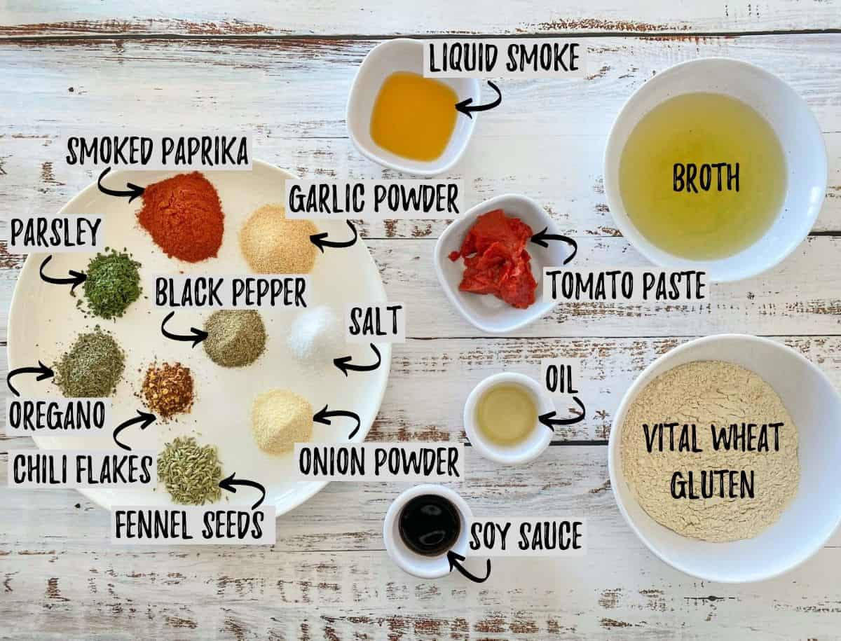 Ingredients to make vegan salami scattered in small bowls.