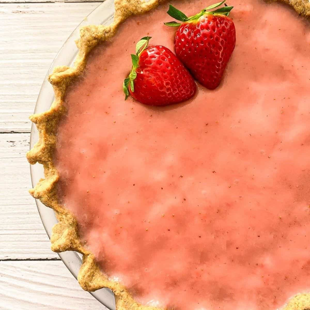 Close up of strawberry pie in pie plate.