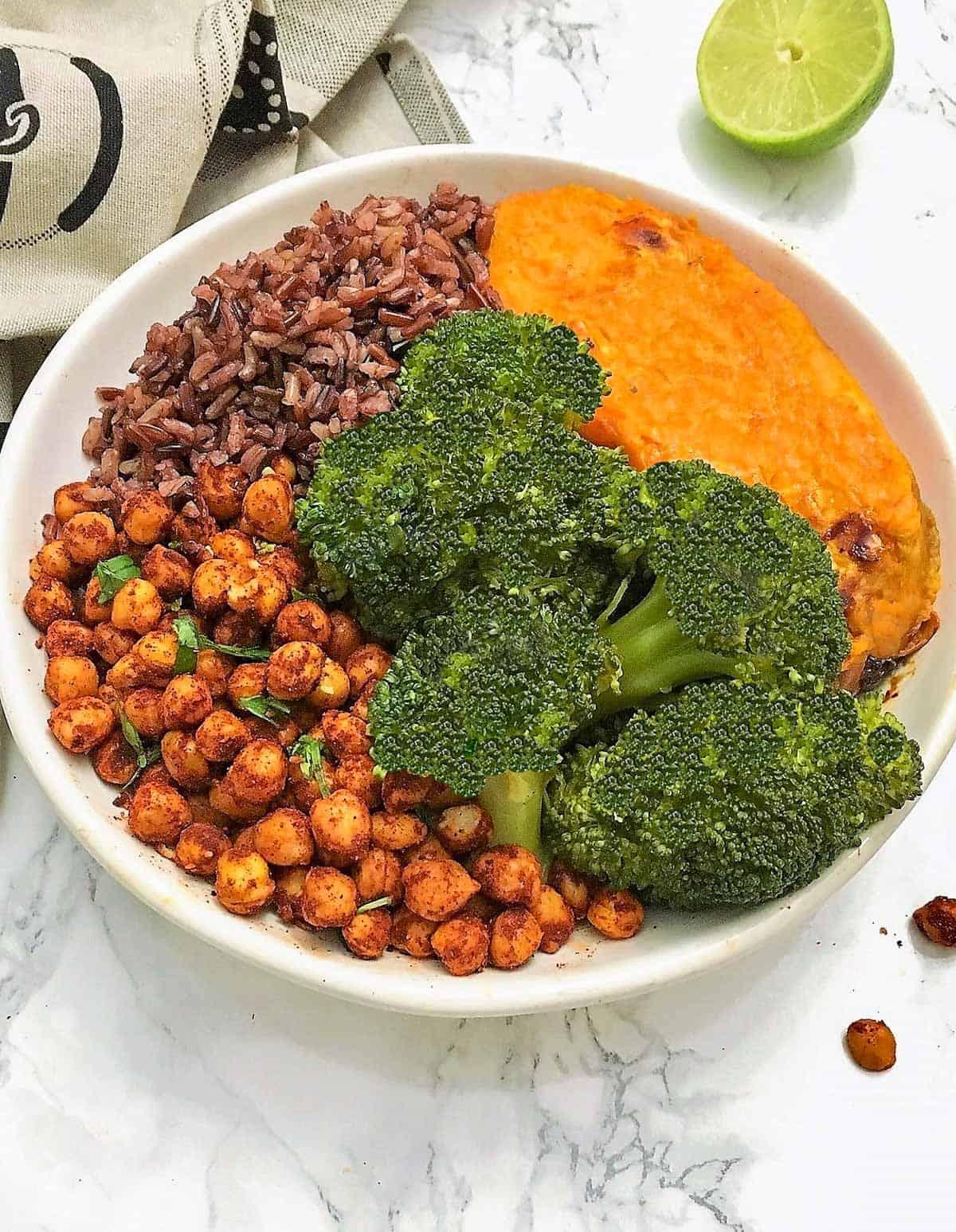 Bowl of rice, broccoli, sweet potato and chickpeas.