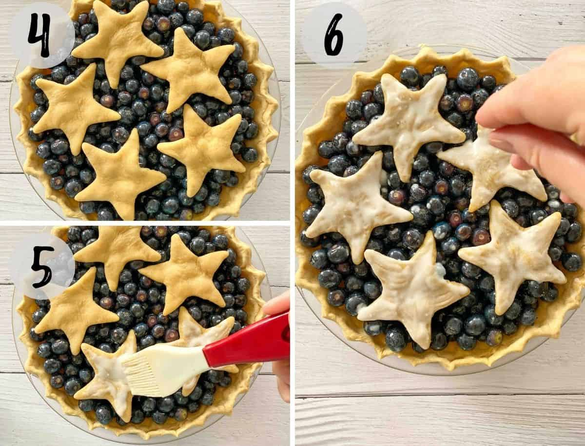 Uncooked blueberry pie being brushed with milk and sprinkled with sugar on top.