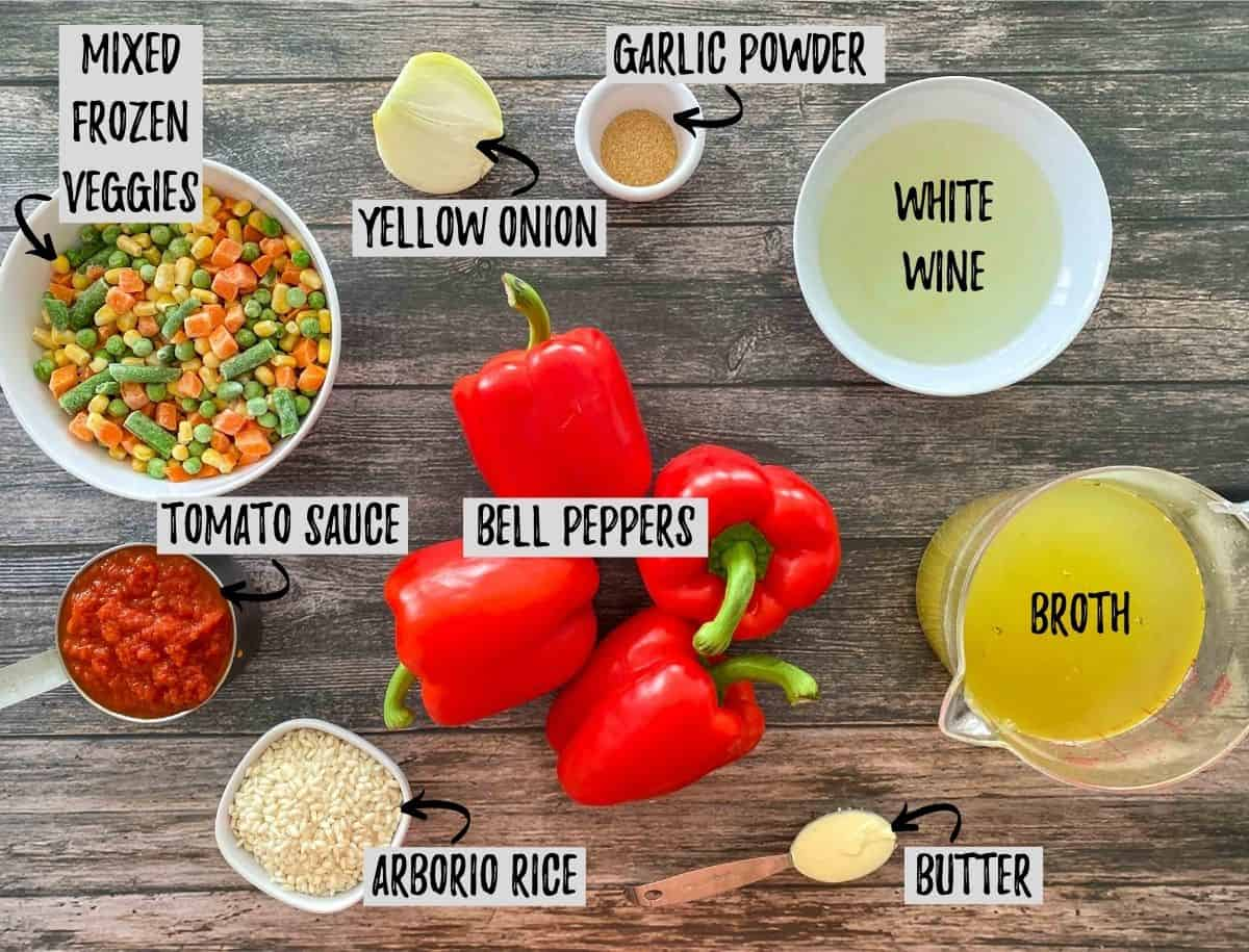 Ingredients needed to make stuffed peppers scattered on brown deck.