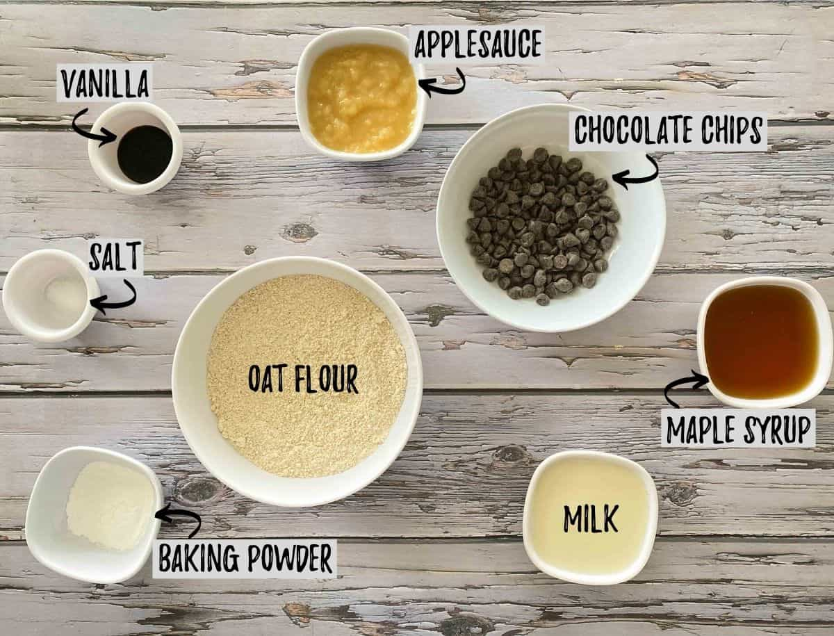 Ingredients needed to make cookies in separate small bowls on grey deck.