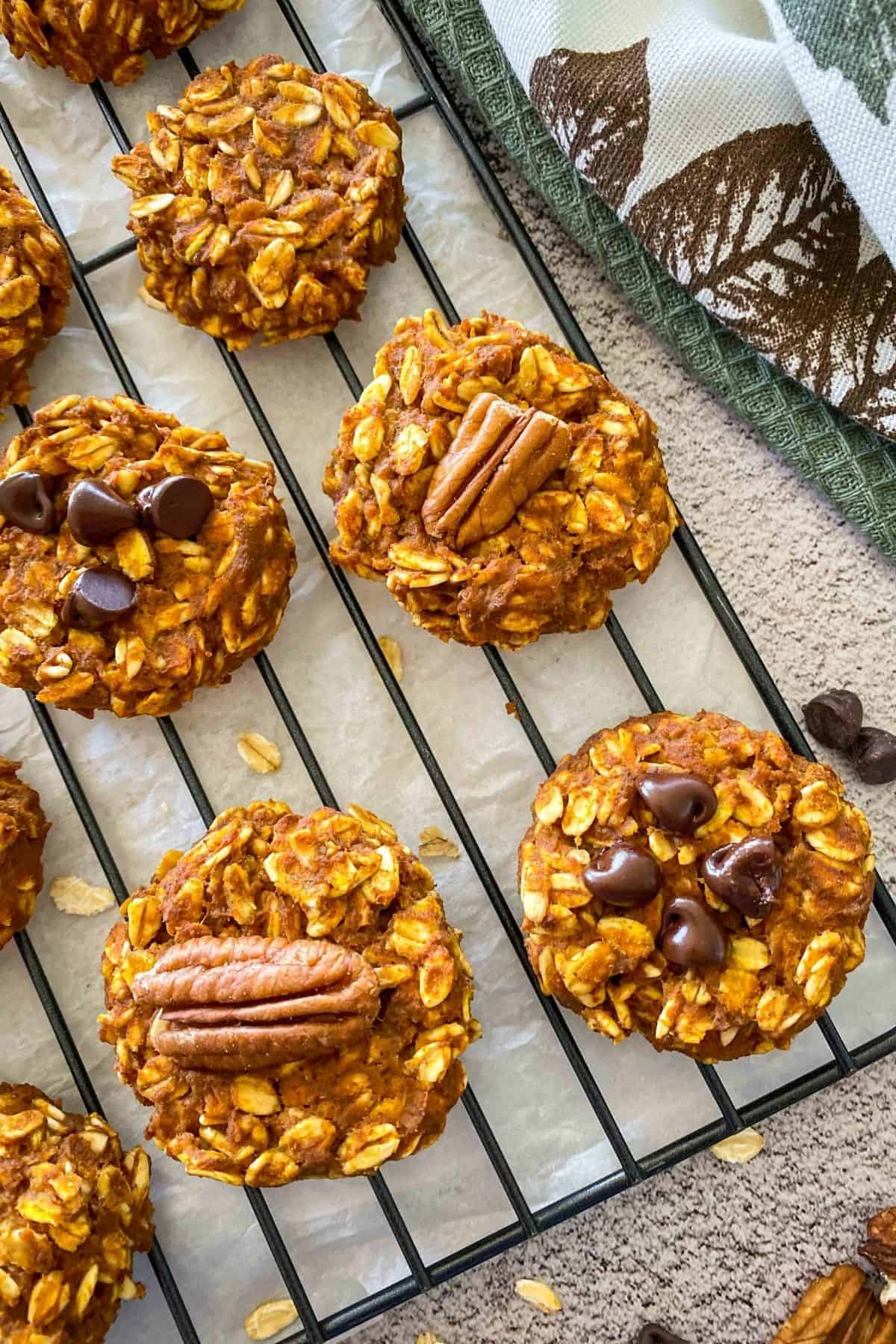 Close up of pumpkin oatmeal cookies on cooling rack.