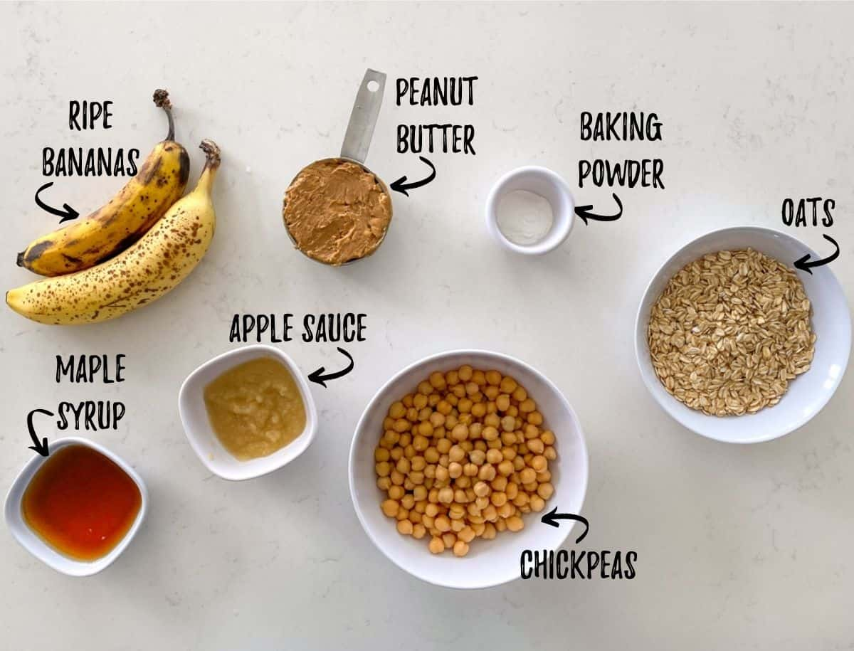 Ingredients needed to make healthy Halloween cookies scattered in prep bowls on counter.