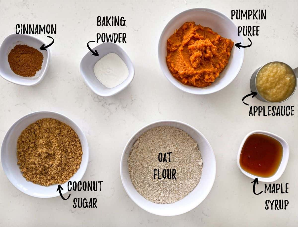 Ingredients to make pumpkin donuts scattered on kitchen counter.