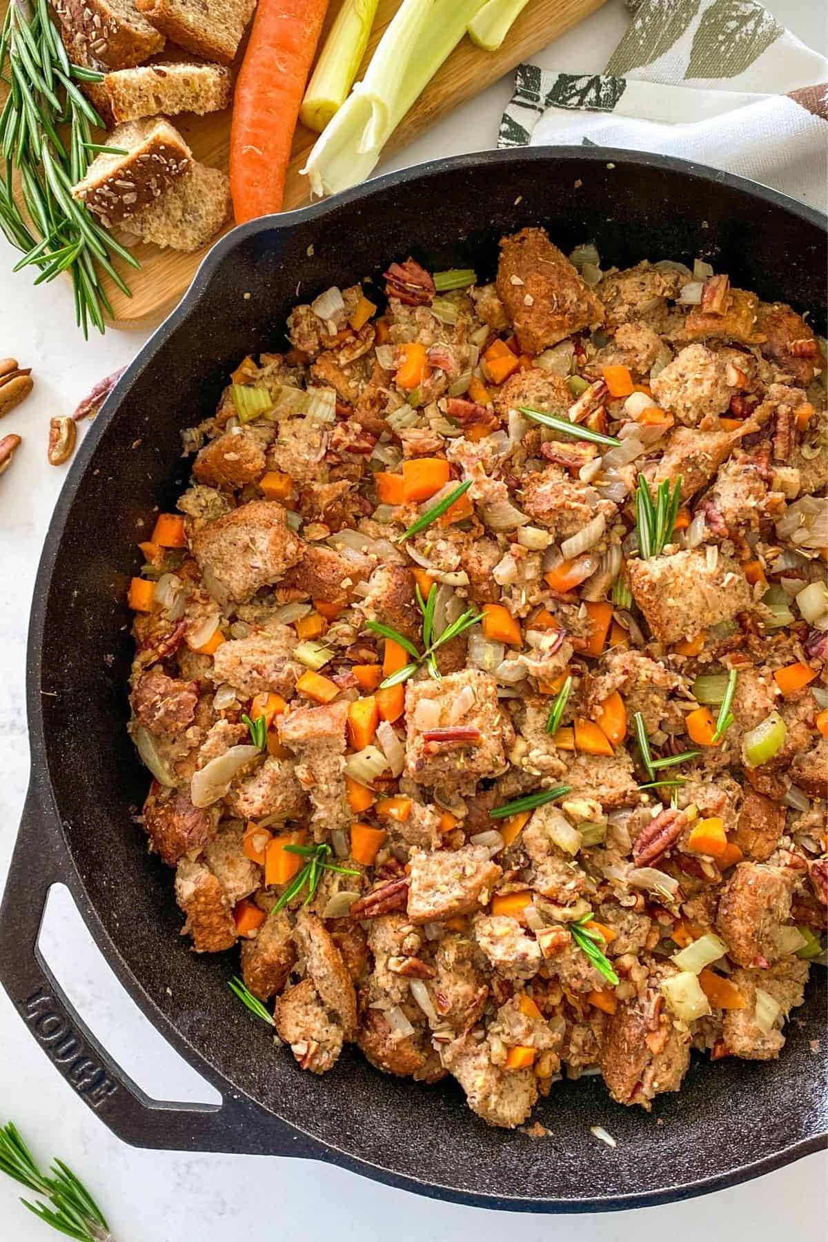 Cast iron pan filled with vegan stuffing.